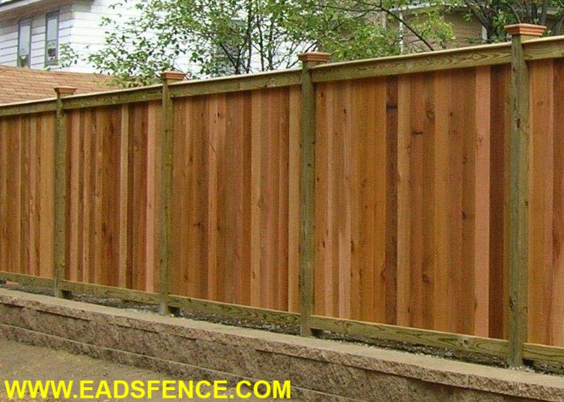 Cedar Good Neighbor Privacy Fence with Angled Cap Board and Federal Post Caps